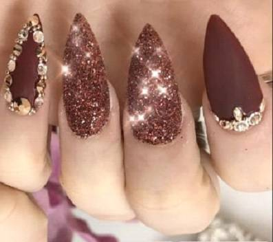 burgundy nail design with rhinestone