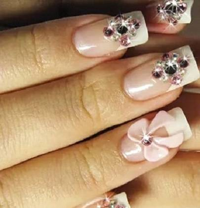 Pink nail design with rhinestone