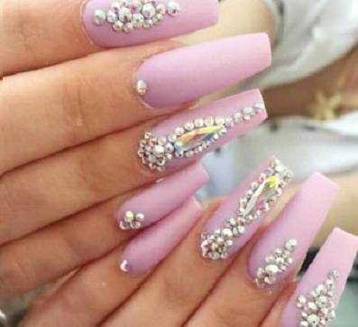 Pink nail design with rhinestones