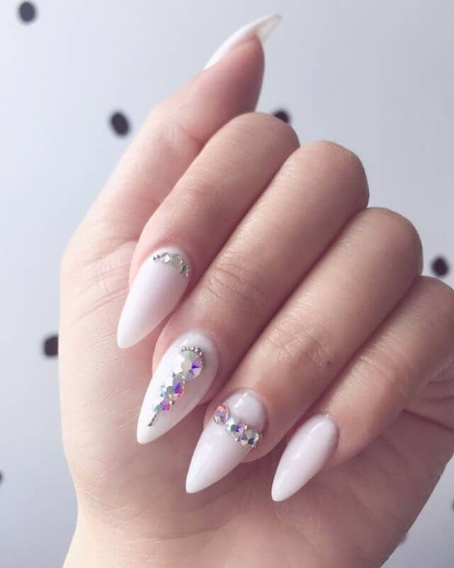 white nails with embedded diamonds