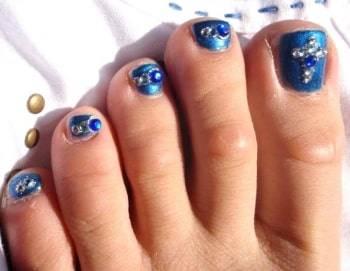 acrylic nail design with rhinestone